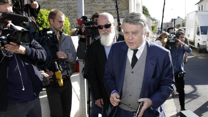 French deputy Gilbert Collard (R) is surrounded by journalists as he arrives to attend the party's executive office at their party's headquarters in Nanterre near Paris
