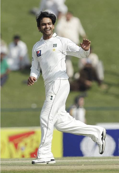 Pakistan's Mohammad Hafeez celebrates taking the wicket of England's Alastair Cook during the fourth day of the second cricket Test match of a three match series between England and Pakistan at  Zayed