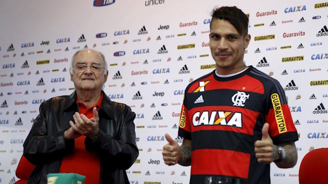 Flamengo's new soccer player Guerrero, accompanied by vice-president D'Agostino, poses wearing the club jersey during his presentation in Rio de Janeiro