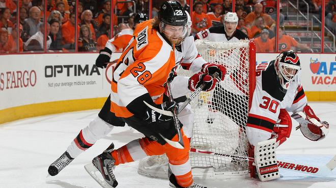 Claude Giroux #28 Of The Philadelphia Flyers Tries To Control The Puck As Martin Brodeur #30 Of The New Jersey Devils Getty Images