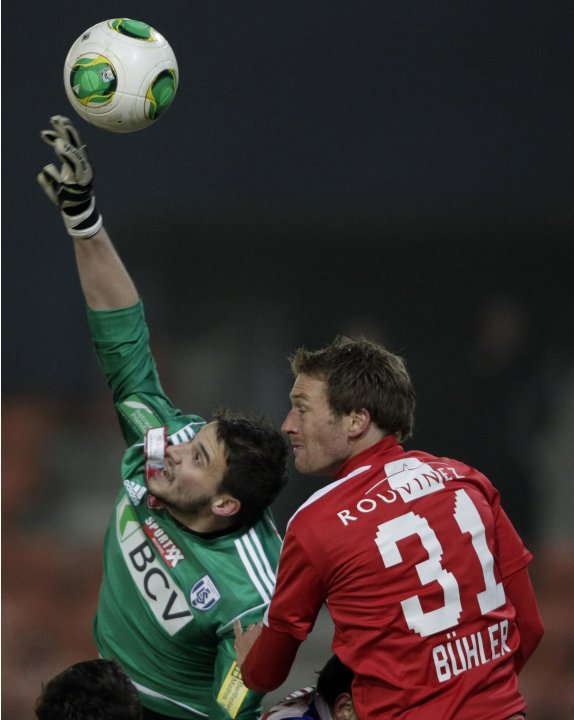 FC Lausanne-Sport's goalkeeper Debonnaire fights for the ball with FC Sion's Buehler during their Swiss Cup quarter final soccer match in Lausanne
