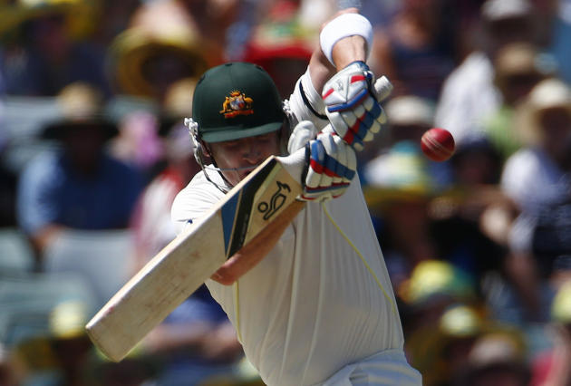 Australia's Haddin tries to cover from a bouncer from England's Root during the first day of the third Ashes cricket test in Perth