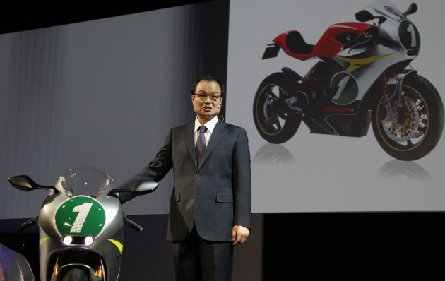 "Honda Motor Co. President Takanobu Ito speaks near the company's concept model ""RC-E"" at the press conference during the press preview of Tokyo Motor Show in Tokyo, Wednesday, Nov. 30, 2011. The Tokyo"