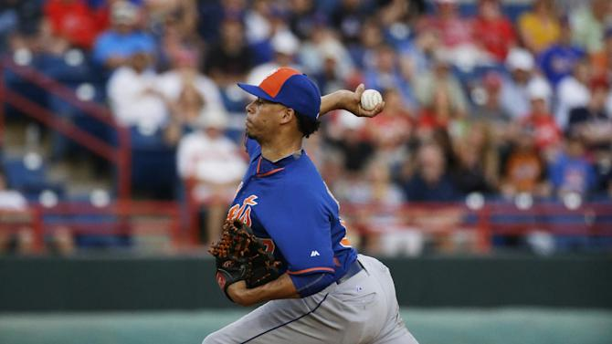New York Mets pitcher Hansel Robles throws in the third inning of an exhibition spring training baseball game against the Washington Nationals, Thursday, March 5, 2015, in Viera, Fla. (AP Photo/David Goldman)