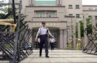 Taiwanese police stand guard outside a courthouse in Taipei. Taiwan has sentenced a retired senior military intelligence officer to three years and six months in jail for leaking classified national secrets