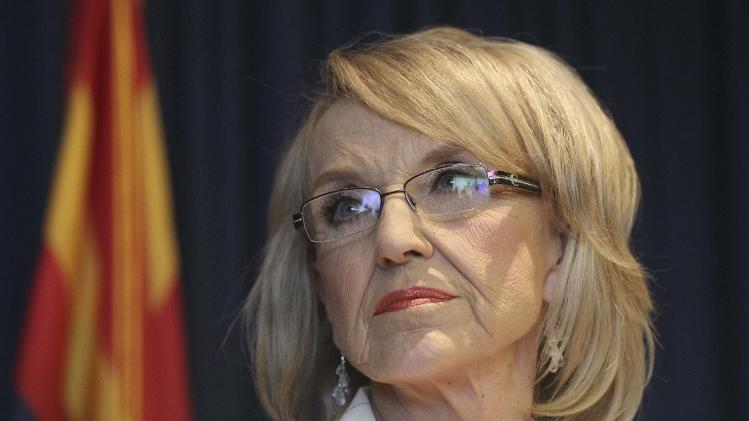 Arizona Governor Jan Brewer listens to a question from a media member in Phoenix.