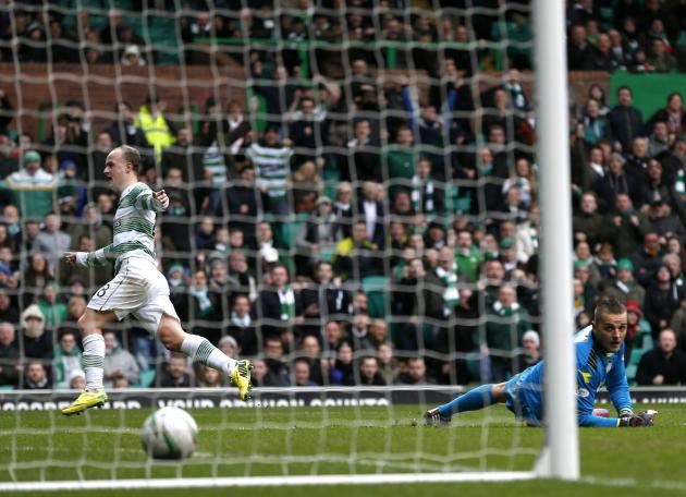 Celtic's Leigh Griffiths puts the ball past St Mirren goalkeeper Marian Kello to score during their Scottish Premier Leaguel soccer match at Celtic Park Stadium in Glasgow
