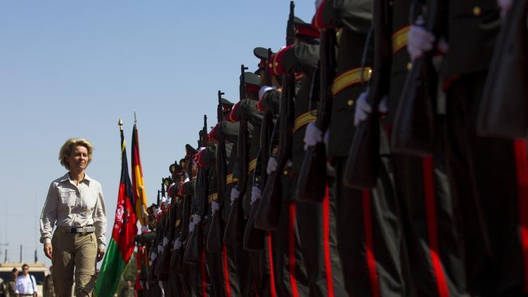 German Defense Minister Ursula von der Leyen inspects the honor guard of the 209th corp of the Afghan army, ANA, at Camp Shaheen outside Mazar-i-Sharif, Afghanistan, Wednesday, July 23, 2014. (AP Photo/Thomas Peter, Pool)