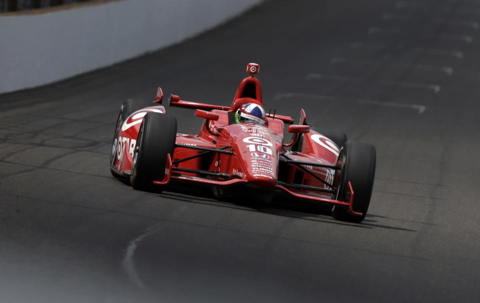 Dario Franchitti, of Scotland, heads into the first turn during a practice session on the second day of qualifications for the Indianapolis 500 auto race at the Indianapolis Motor Speedway in Indianapolis, Sunday, May 19, 2013. (AP Photo/Darron Cummings)