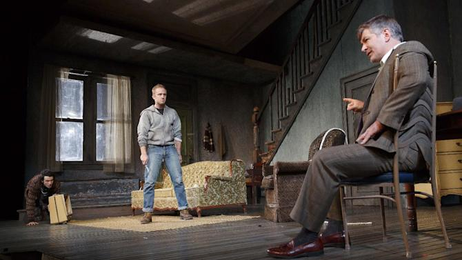 """This theater image released by Boneau/Bryan-Brown shows, from left, Tom Sturridge, Ben Foster and Alec Baldwin during a performance of """"Orphans,"""" at the Gerald Schoenfeld Theatre in New York. (AP Photo/Boneau/Bryan-Brown, Joan Marcus)"""