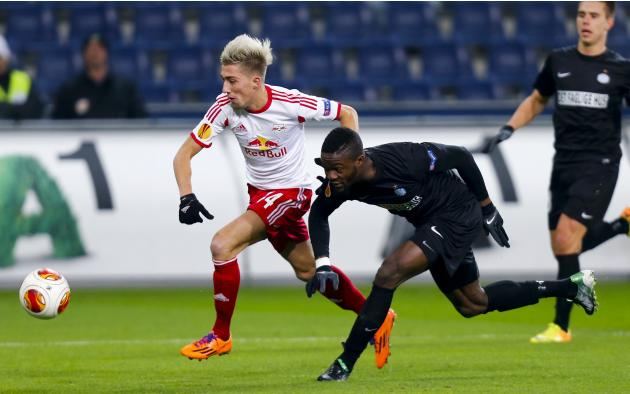 Salzburg's Kampl challenges Esbjerg fB's Drobo-Ampem during their Europa League soccer match in Salzburg