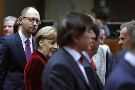 Ukraine's Prime Minister Yatsenyuk, Germany's Chancellor Merkel, Belgium's Prime Minister Di Rupo and Poland's Prime Minister Donald attend a summit on Ukraine in Brussels
