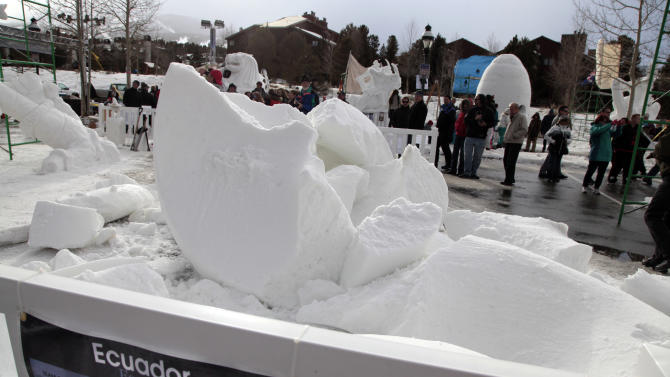 The snow sculpture of Team Ecuador, called Fossils collapsed during it's creation at the 23 annual International Snow Sculpture Championships in Breckenridge, Colo., on Friday, Jan. 25, 2013. Each sculpture started out of a 12 foot tall, 20-ton block of compacted snow at the outdoor art gallery. The sculptures will remain on display through Feb. 3, 2013, weather permitting. Visit www.gobreck.com for more information. (Nathan Bilow / AP Images for the Breckenridge Resort Chamber)