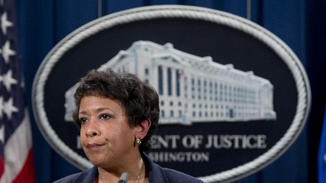 Attorney General Loretta Lynch pauses as she speaks during a news conference at the Justice Department in Washington, Wednesday, Feb. 10, 2016, about Ferguson, Missouri. The federal government sued Ferguson on Wednesday, one day after the city council voted to revise an agreement aimed at improving the way police and courts treat poor people and minorities in the St. Louis suburb. (AP Photo/Carolyn Kaster)