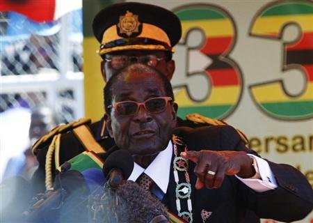 Zimbabwe's President Mugabe addresses crowds gathered for the country's 33rd independence celebrations in Harare