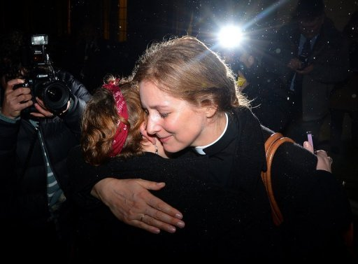"Two members of the clergy embrace outside Church House in central London on November 20. The Church of England has ""undoubtedly"" lost credibility after voting to reject the appointment of women bishops, its leader the Archbishop of Canterbury said Wednesday."