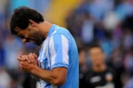 Malaga&#39;s Dutch striker Ruud van Nistelrooy, shown here in April, retired from professional football on Monday, ending a stellar career that included stints with Manchester United and Real Madrid