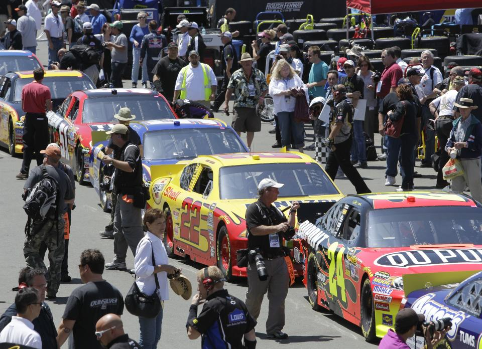 NASCAR drivers line up in pit row in preparation for practice laps for Sunday's NASCAR Toyota Save Mart 350 auto race on Friday, June 24, 2011, at Infineon Raceway in Sonoma, Calif. (AP Photo/Ben Margot)