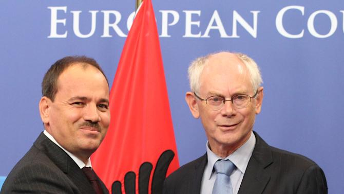 European Council President Herman Van Rompuy, right, welcomes Albania's President Bujar Nishani, at the European Council building in Brussels, Monday, Sept. 17, 2012.  (AP Photo/Yves Logghe)