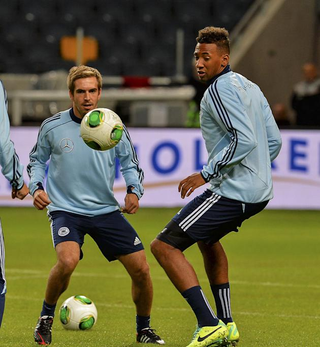 Germany's Philipp Lahm, left and Jerome Boateng during the training at Friends Arena in Stockholm, Sweden, Monday Oct.14, 2013. Germany will play against Sweden in the last soccer World Cup qualifier