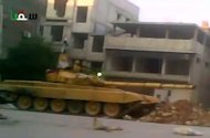 An image grab from a video uploaded on YouTube shows a Syrian army tank stationed in Saqba on the outskirts of Damascus. AFP is not in a position to independently verify this image