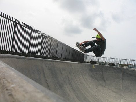 Photo of a skateboarder at a skatepark