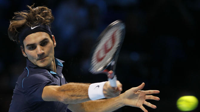 Roger Federer of Switzerland plays a return to Rafael Nadal of Spain during their round robin singles match at the ATP World Tour Finals, at the O2 arena in London, Tuesday, Nov. 22, 2011. (AP Photo/Kirsty Wigglesworth)