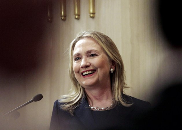 U. S. Secretary of State Hillary Rodham Clinton reacts during a joint press conference with Egyptian Foreign Minister Mohammed Kamel Amr, not shown, at the presidential palace in Cairo, Egypt, Saturday, July 14, 2012. (AP Photo/Maya Alleruzzo)