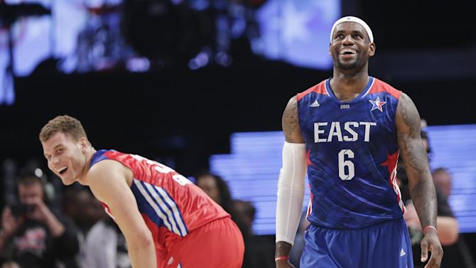 West Team's Blake Griffin of the Los Angeles Clippers and East Team's LeBron James of the Miamia Heat laugh during the first half of the NBA All-Star basketball game Sunday, Feb. 17, 2013, in Houston. (AP Photo/Eric Gay)