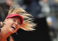 Russia&#39;s Maria Sharapova returns a ball to China&#39;s Li Na during the final of the WTA Rome Tennis Masters. Sharapova won 4-6, 6-4, 7-6 (7/5)