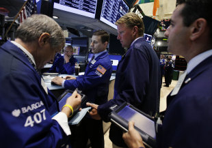 Stock traders. Photo credit AP
