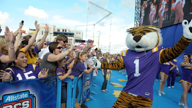 COMMERCIAL IMAGE - In this photograph taken by AP Images for Allstate, Louisiana State University mascot, Mike the Tiger, high-fives a Tigers fan at the Allstate Fan Fest during the school's pep rally in New Orleans, Jan. 8, 2012. LSU will take on Alabama at the Allstate BCS National Championship in the Mercedes-Benz Superdome on Jan. 9, 2012. (Cheryl Gerber/AP Images for Allstate)