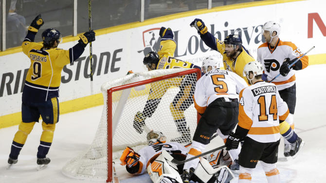 Philadelphia Flyers goalie Ray Emery lies on the ice as Nashville Predators' Filip Forsberg (9), of Sweden, and Mike Ribeiro (63) celebrate a goal by Mike Fisher, second from right at top, in the second period of an NHL hockey game Saturday, Dec. 27, 2014, in Nashville, Tenn. (AP Photo/Mark Humphrey)
