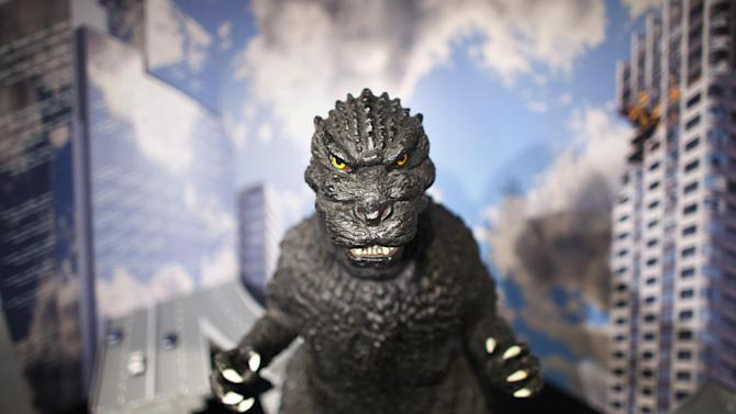 """In this Monday, April 28, 2014 photo, a large size figure of Godzilla in a diorama is on display at Cheepa's gallery in Tokyo. Godzilla-lovers in this nation where the stomping all began say their iconic hero falls into a special phantasmal category called """"kaiju,"""" different from more mundane monsters like King Kong or Frankenstein. (AP Photo/Junji Kurokawa)"""