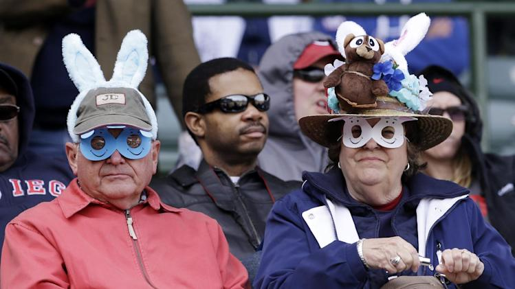 Baseball fans wearing Easter-related hats look to the field before a baseball game between the Cincinnati Reds and the Chicago Cubs in Chicago, Saturday, April 19, 2014