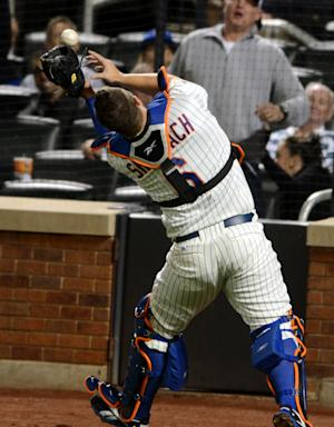 New York Mets catcher Kelly Shoppach misplays a foul ball hit by the Washington Nationals' Kurt Suzuki in the third inning of the baseball game in New York, Monday, Sept. 10, 2012. Suzuki hit a home run on the next pitch. (AP Photo/Henny Ray Abrams)