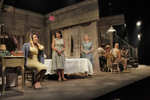 "In this April 2, 2012 photo provided by Springer Associates, from left, Blanche, played by Nicole Ari Parker, gets ready to leave as Stella, played by Daphne Rubin-Vega, and Eunice, played by Amelia Campbell, look on in a scene from ""A Streetcar Named Desire"" at the Broadhurst Theatre in New York. A talented multi-racial cast tackles Tennessee Williams' Pulitzer Prize-winning play about the clash between an aging and delusional Southern belle and her brutish brother-in-law. It opens Sunday, April 22, 2012. (AP Photo/Springer Associates, Ken Howard)"