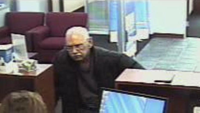 This Saturday, Feb. 9, 2013 surveillance photo provided by the FBI shows 73-year-old Walter Unbehaun, an ex-convict from Rock Hill., S.C., during a bank robbery in Niles, Ill. Unbehaun allegedly told investigators he became accustomed to life in prison and intended to get caught for a weekend bank robbery so he could live his final years behind bars.   (AP Photo/FBI)