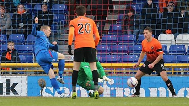 Billy McKay, blue shirt, opens the scoring for Inverness