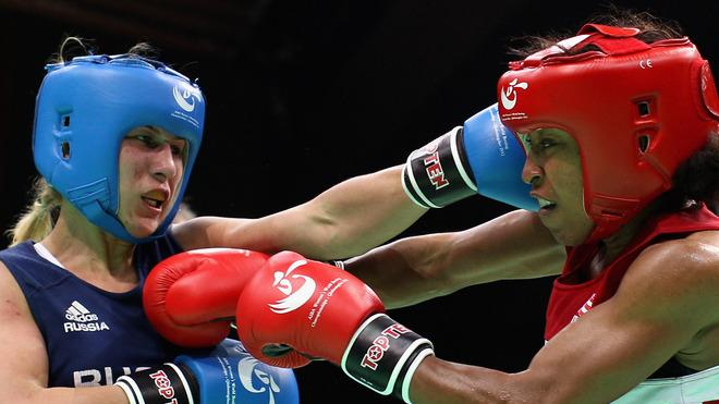 Raquel Miller (Red) Of The United States Fights Against Irina Poteyeva (Blue) Of Russia In The Women's 69kg Getty Images