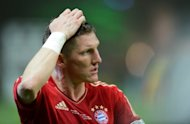 "Bayern Munich's Bastian Schweinsteiger reacts after his team loses in the German Cup final against Borussia Dortmund on May 12. Bayern coach Jupp Heynckes admitted the Champions League finalists suffered a defensive ""catastrophe"" after they were blasted 5-2 by Dortmund"