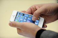 Concerns that the latest iPhone may not be a hit in China caused Apple shares on Friday to extend their slide from a record high price hit in September