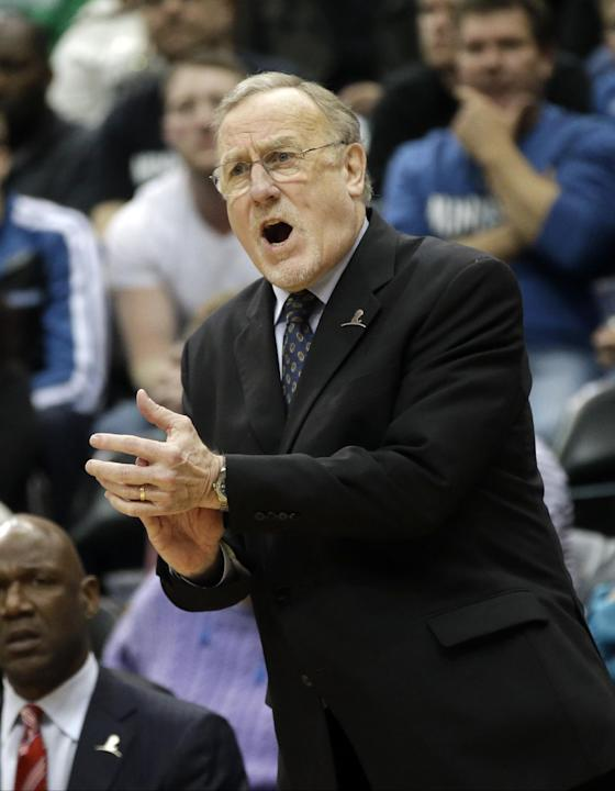 Minnesota Timberwolves head coach Rick Adelman encourages his team in the second half of an NBA basketball game against the Detroit Pistons, Friday, March 7, 2014, in Minneapolis. The Timberwolves won