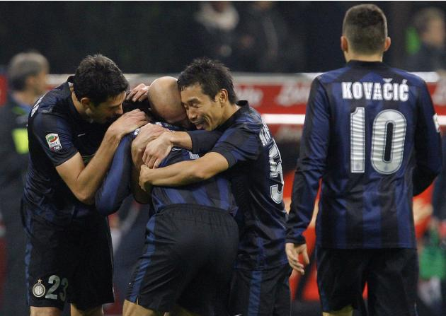 Inter Milan's Yuto Nagatomo celebrates with his team mates after scoring a goal against Livorno during their Italian Serie A soccer match at the San Siro stadium in Milan