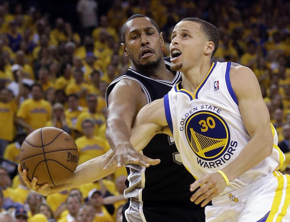 San Antonio Spurs center Boris Diaw (33) blocks a shot by Golden State Warriors guard Stephen Curry (30) in the second half of Game 6 of a Western Conference semifinal NBA basketball playoff series in Oakland, Calif., Thursday, May 16, 2013. (AP Photo/Jeff Chiu)