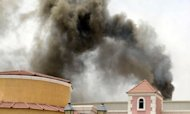 Smoke rises from the Villaggio Mall in Doha after a fire broke out on May 28. Firefighters in Qatar told Wednesday how they tried to rescue 13 children trapped by the blaze in a mall nursery but by the time they reached the toddlers most were dead, huddled in the arms of two fellow firemen who perished during the rescue attempt
