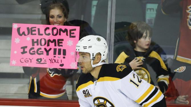 Boston Bruins' Jarome Iginla takes part in the pre-game skate before first period NHL hockey action against the Calgary Flames in Calgary, Alberta Tuesday, Dec. 10, 2013. (AP Photo/The Canadian Press, Jeff McIntosh)