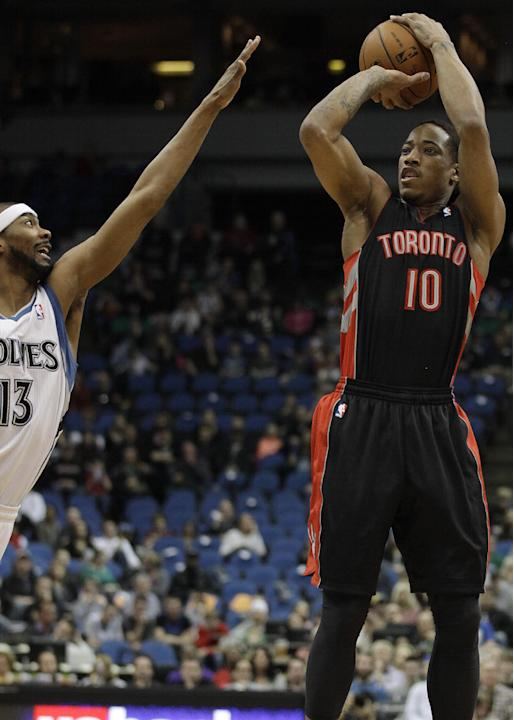 Toronto Raptors guard DeMar DeRozan (10) shoots against Minnesota Timberwolves guard Corey Brewer (13) in the first half of an NBA basketball game on Sunday, March 9, 2014, in Minneapolis
