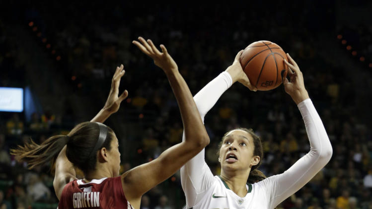 CORRECTS YEAR - Baylor's Brittney Griner (42) shoots against Oklahoma's Nicole Griffin (4) during the first half of an NCAA college basketball game Saturday, Jan. 26, 2013, in Waco Texas. (AP Photo/LM Otero)