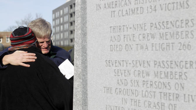 Kevin Root, right, hugs Fern Liddy near a just-unveiled monument to the victims of the midair plane collision on Dec. 16, 1960, in Green-Wood Cemetery in New York, Thursday, Dec. 16, 2010. Both of Root's parents, Sam and Florence Root, were killed in the collision; Sam Root was also Liddy's employer at the time. (AP Photo/Seth Wenig)